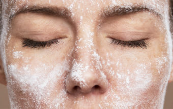 Women's face with Magical Peeling powder and closed eyes